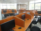 The main computer center. This cluster of 35 terminals is the largest of several computer clusters throughout the library, which also has wireless Internet access.