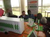 Rwandan schoolchildren using One Laptop Per Child / One Laptop Per Child (OLPC) Rwanda laptops at a booth assembled for the Kigali Public Library inauguration.