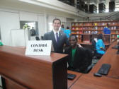 One of our Kigali Public Library staff members working at the front desk.