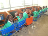 But we weren't the only ones who were excited! Rwandan schoolchildren using the computers in the Kigali Public Library's children's section.